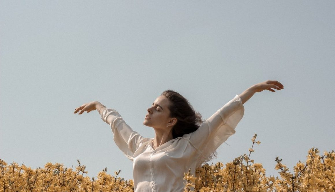 woman taking care of her mental health in nature