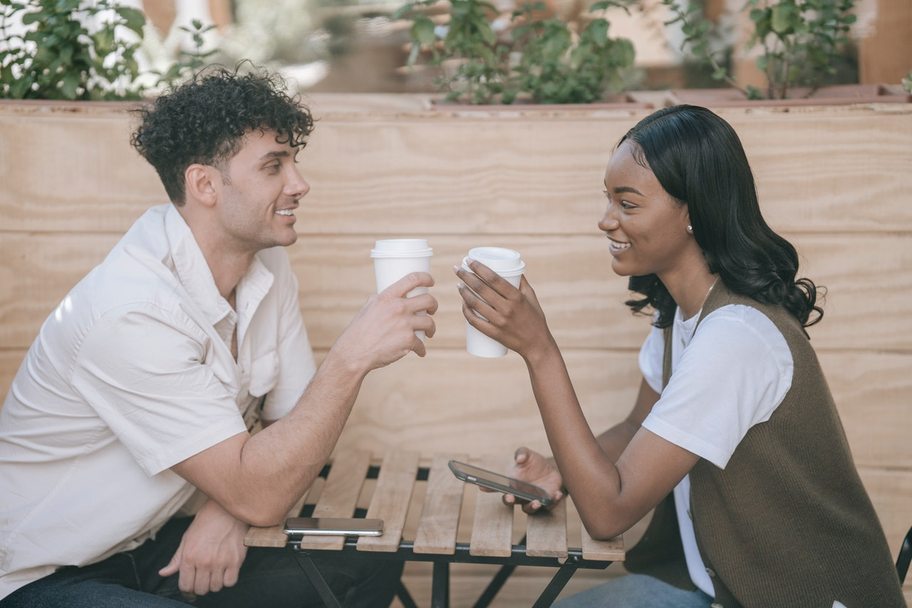two people drinking coffee and wasting time
